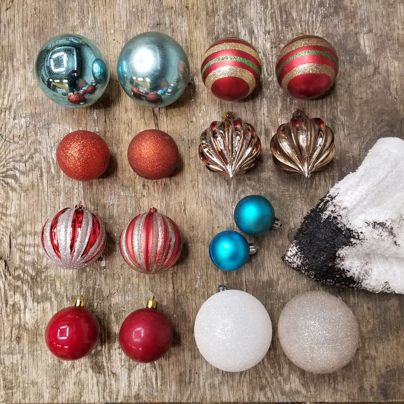 Age and distress cheap plastic ornaments to look like vintage treasures.  DIY by Aaron Christensen
