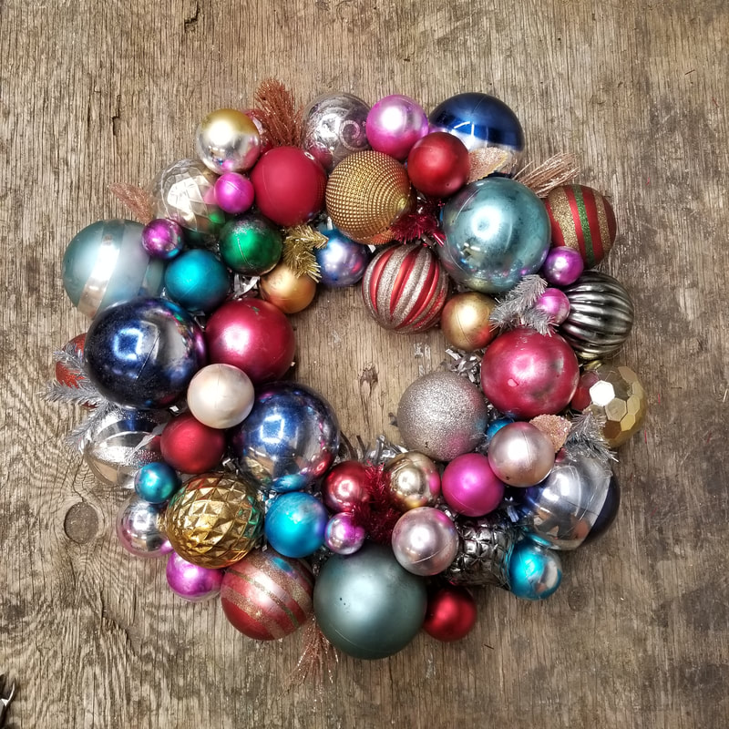 Vintage look wreath created using altered inexpensive plastic ornaments by Aaron Christensen.