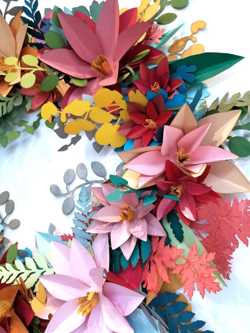 cut paper floral wreath by Embellishments Studio