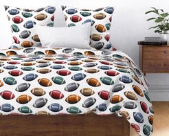 Football Bedding using fabric by Aaron Christensen.  Available from Spoonflower.com