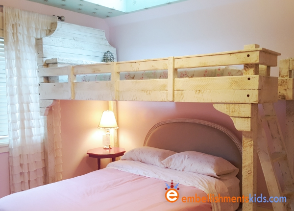 Custom loft bed made of reclaimed fir for a girls bedroom by Aaron Christensen, the kids designer.