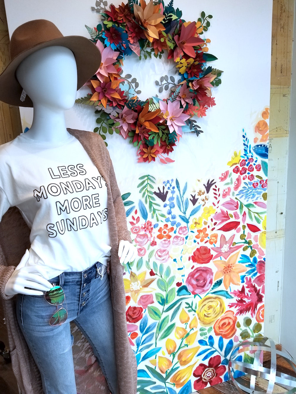 Spring Window Display featuring cut paper florals